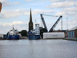 Goole began development as a canal and river port in 1826 with the opening of the Aire & Calder Navigation to the River Ouse. It became a significant inland port and the docks expanded throughout the 19th century. Aldam Dock opened in 1881.