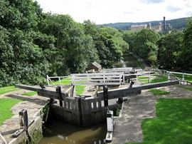 The Bingley five-rise lock, 1774, on the Leeds and Liverpool Canal, built 1770-1816, connecting Leeds with ports on the east and west coasts. Many textile mills were built alongside the Canal, such as Damart's Bowling Green Mill, in 1871.