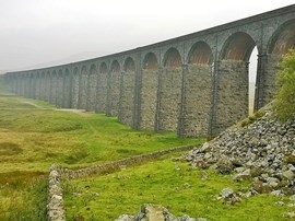 In the 19th century railways spread across the UK, to carry goods and passengers, thereby boosting the national economy enormously. The railway companies significantly developed mechanical and structural engineering, and in constructing their routes they built many impressive structures. One such is the Ribblehead Viaduct, opened in 1874, on the Midland Railway's Settle-Carlisle line, as part of its route to Scotland.
